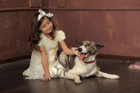 Vintage portrait of a little girl with dog Stock Photo - 13146508