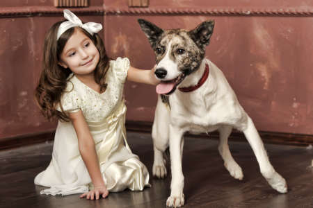 Vintage portrait of a little girl with dog Stock Photo - 13146489