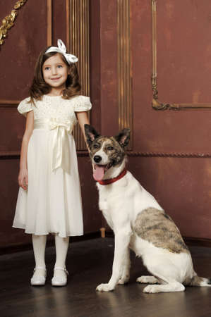Vintage portrait of a little girl with dog Stock Photo - 13146507