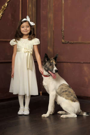 Vintage portrait of a little girl with dog Stock Photo - 13146496