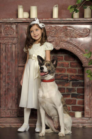 Vintage portrait of a little girl with dog photo