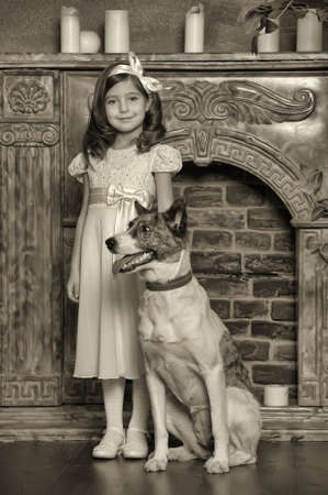 Vintage portrait of a little girl with dog Stock Photo - 13146582