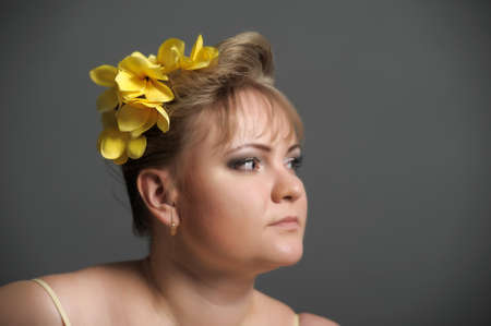 the woman with flowers in hair photo