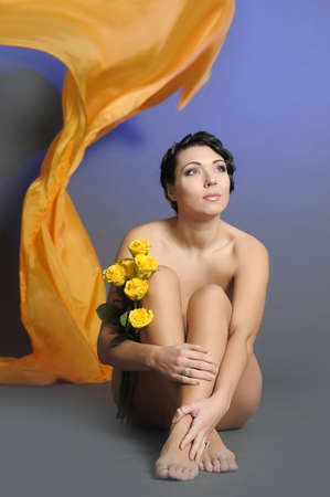 beautiful young woman sitting with yellow roses Stock Photo - 14161988