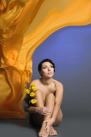 beautiful young woman sitting with yellow roses Stock Photo - 14161997