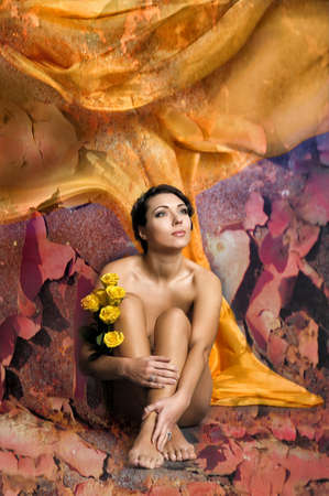 teenager nude: beautiful young woman sitting with yellow roses
