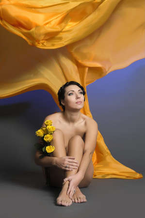 beautiful young woman sitting with yellow roses Stock Photo - 14162000