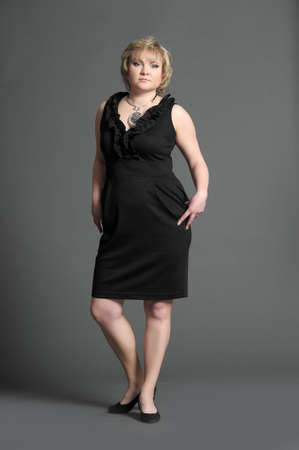 woman in a black dress photo