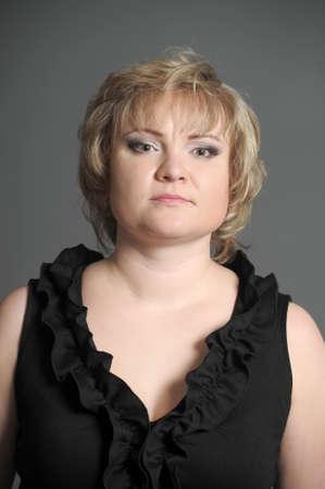 woman in a black dress photo