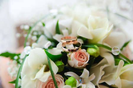 bridal bouquet and wedding rings photo