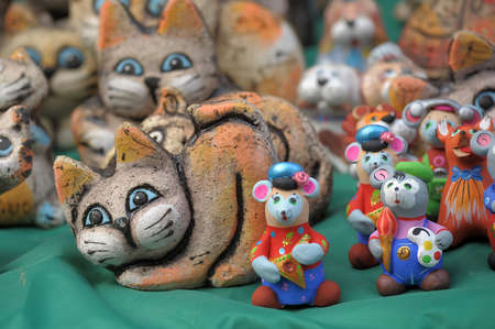 Amusing ceramic figures of cats Stock Photo - 13235302