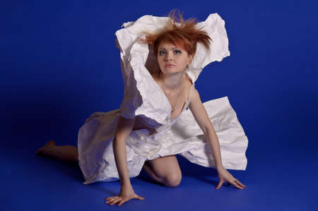 woman in a dress made of paper photo