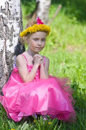 girl with a wreath of dandelions Stock Photo - 13279966