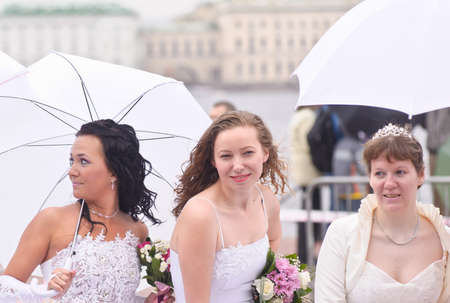 Action «Run-away brides of Cosmopolitan» — a flashmob of long-distance scale which was spent the seventh year.  Russia, St. Petersburg Stock Photo - 13337840