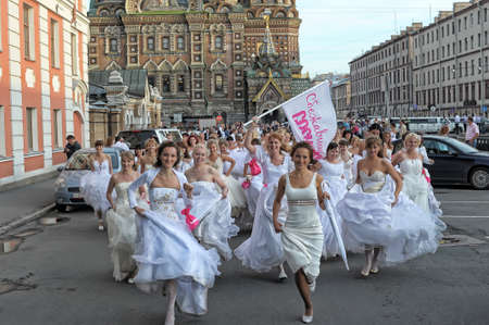 Action «Run-away brides of Cosmopolitan» — a flashmob of long-distance scale which was spent the seventh year.  Russia, St. Petersburg Stock Photo - 13337933