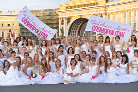 Action «Run-away brides of Cosmopolitan» — a flashmob of long-distance scale which was spent the seventh year.  Russia, St. Petersburg Stock Photo - 13337936