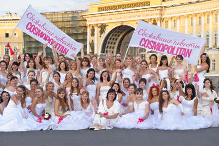 Action «Run-away brides of Cosmopolitan» — a flashmob of long-distance scale which was spent the seventh year.  Russia, St. Petersburg Stock Photo - 13337937