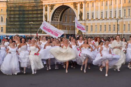 Action «Run-away brides of Cosmopolitan» — a flashmob of long-distance scale which was spent the seventh year.  Russia, St. Petersburg Stock Photo - 13337927