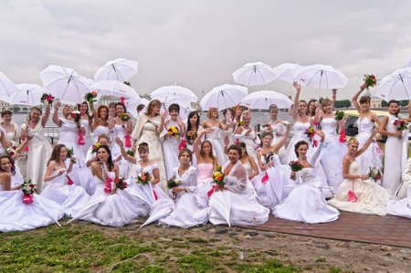 Action «Run-away brides of Cosmopolitan» — a flashmob of long-distance scale which was spent the seventh year.  Russia, St. Petersburg Stock Photo - 13365034