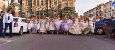 Action «Run-away brides of Cosmopolitan» — a flashmob of long-distance scale which was spent the seventh year.  Russia, St. Petersburg Stock Photo - 13386457