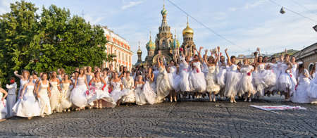 Action «Run-away brides of Cosmopolitan» — a flashmob of long-distance scale which was spent the seventh year.  Russia, St. Petersburg Stock Photo - 13386475