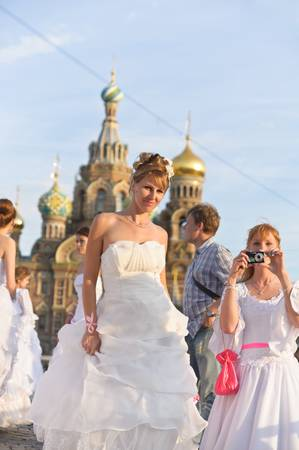 Action «Run-away brides of Cosmopolitan» — a flashmob of long-distance scale which was spent the seventh year.  Russia, St. Petersburg Stock Photo - 13386450