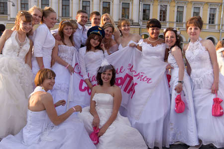 Action «Run-away brides of Cosmopolitan» — a flashmob of long-distance scale which was spent the seventh year.  Russia, St. Petersburg Stock Photo - 13386452