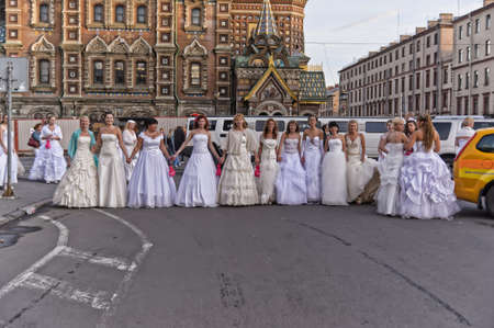 Action «Run-away brides of Cosmopolitan» — a flashmob of long-distance scale which was spent the seventh year.  Russia, St. Petersburg Stock Photo - 13436719