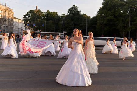 Action «Run-away brides of Cosmopolitan» — a flashmob of long-distance scale which was spent the seventh year.  Russia, St. Petersburg Stock Photo - 13386451