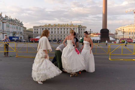 Action «Run-away brides of Cosmopolitan» — a flashmob of long-distance scale which was spent the seventh year.  Russia, St. Petersburg Stock Photo - 13386456