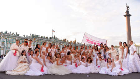 Action «Run-away brides of Cosmopolitan» — a flashmob of long-distance scale which was spent the seventh year.  Russia, St. Petersburg Stock Photo - 13386453