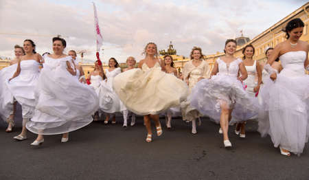 Action «Run-away brides of Cosmopolitan» — a flashmob of long-distance scale which was spent the seventh year.  Russia, St. Petersburg Stock Photo - 13436699