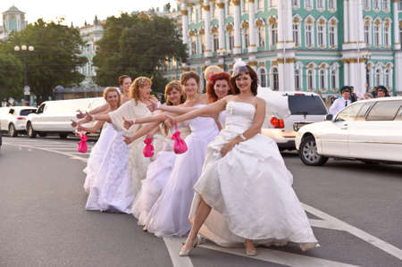 Action «Run-away brides of Cosmopolitan» — a flashmob of long-distance scale which was spent the seventh year.  Russia, St. Petersburg Stock Photo - 13386483