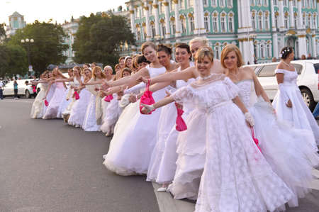 Action «Run-away brides of Cosmopolitan» — a flashmob of long-distance scale which was spent the seventh year.  Russia, St. Petersburg Stock Photo - 13386485