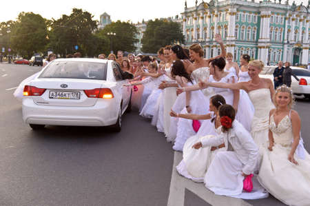 Action «Run-away brides of Cosmopolitan» — a flashmob of long-distance scale which was spent the seventh year.  Russia, St. Petersburg Stock Photo - 13386486