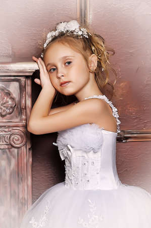 The little girl in a dress of the bride Stock Photo - 13384249