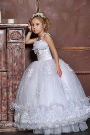 The little girl in a dress of the bride Stock Photo - 13384259