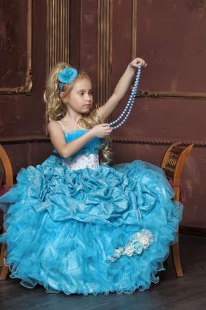 nude little girls: Маленькая девочка в нарядном голубом платье Фото со стока