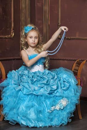 little girl in a smart blue dress photo