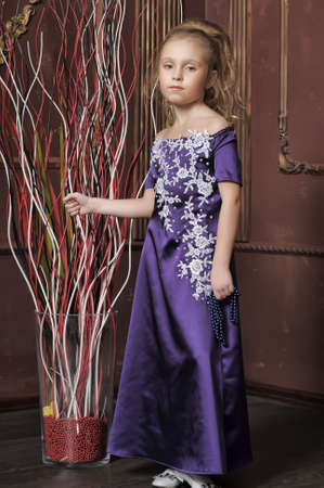 beautiful girl in purple smart dress Stock Photo - 17880188