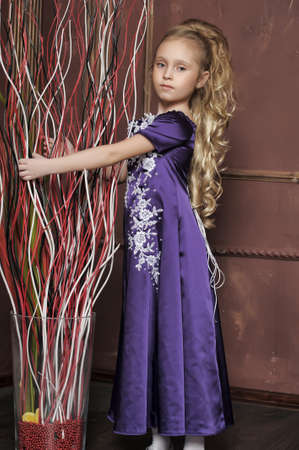 beautiful girl in purple smart dress photo