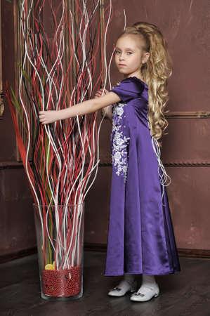 beautiful girl in purple smart dress Stock Photo - 17893106