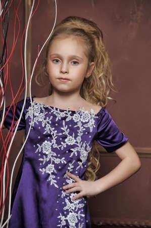 beautiful girl in purple smart dress Stock Photo - 17880199
