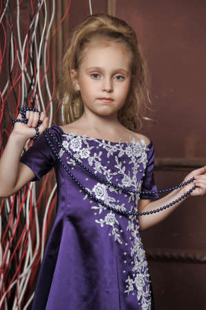 beautiful girl in purple smart dress Stock Photo - 17893105