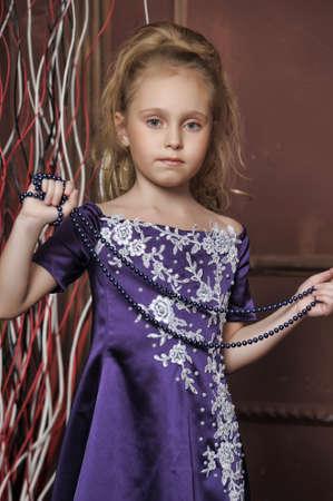 beautiful girl in purple smart dress Stock Photo - 17893105