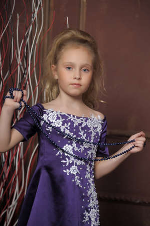 beautiful girl in purple smart dress Stock Photo - 17893100