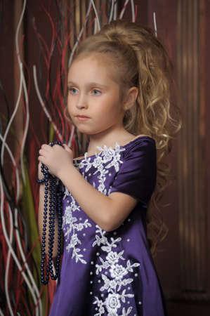 beautiful girl in purple smart dress Stock Photo - 17893104