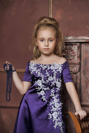 beautiful girl in purple smart dress Stock Photo - 17893098
