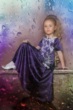 beautiful girl in purple smart dress Stock Photo - 17893095
