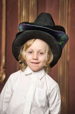 the boy measures at once many hats Stock Photo - 13497675